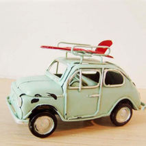 Sky blue miniature car with red surfboard