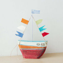 Ceramic sailing boat with colourful flags