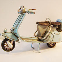 Sky blue Vespa bike, collectible retro miniature.