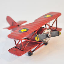 Miniature, retro metal red aeroplane