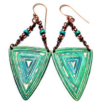 Distressed shields and beaded accent statement earrings